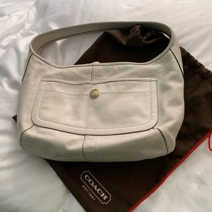 White leather purse.